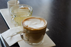 Cappuccino with hot tea and sugar. In cafe Royalty Free Stock Photos