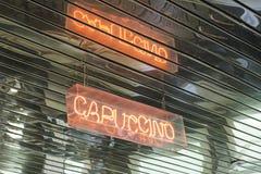 Cappuccino illuminato del segno Immagine Stock