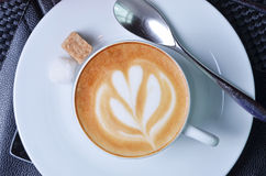 Cappuccino with latte art Royalty Free Stock Image