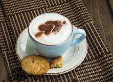 Cappuccino latte coffee with cocoa heart-shape and cookies Royalty Free Stock Images