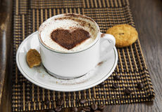 Cappuccino latte coffee with cocoa heart-shape and cookies Royalty Free Stock Photo