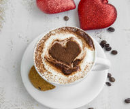 Cappuccino latte coffee with cocoa heart-shape and cookies Stock Image