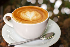 Cappuccino or latte coffee with heart royalty free stock images