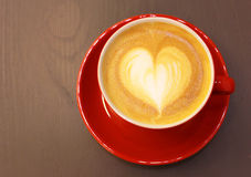 Cappuccino or latte coffee with heart shape Royalty Free Stock Photos