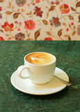 Cappuccino or latte coffee on table with chair Stock Photos