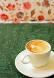 Cappuccino or latte coffee with flower chair Stock Images