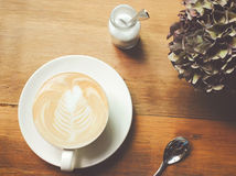 Cappuccino or latte coffee on table Royalty Free Stock Image