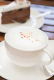 Cappuccino or latte in white cup. stock image