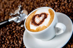 Cappuccino on a lot of coffee beans Stock Photography