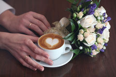 Cappuccino lovers flowers heart coffee Stock Photography