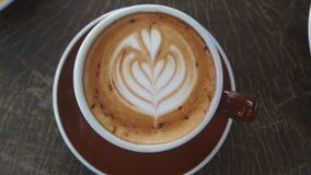 Cappuccino med lattekonst Arkivbilder