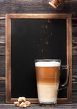 Cappuccino and menu chalkboard. Cappuccino or latte and a chalk board with space for text Stock Photos