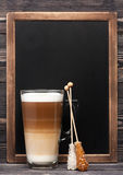 Cappuccino and menu chalkboard. Cappuccino or latte and  chalk board with space for text Stock Images