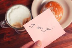 Cappuccino mug, cake and notes I love you on a wooden background. Concept Valentine Day.  stock images