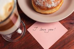 Cappuccino mug, cake and notes I love you on a wooden background. Concept Valentine Day.  stock photos