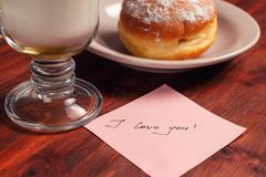 Cappuccino mug, cake and notes I love you on a wooden background. Concept Valentine Day.  royalty free stock photo