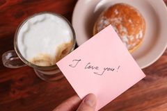 Cappuccino mug, cake and notes I love you on a wooden background. Concept Valentine Day.  royalty free stock photography