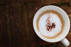 Cappuccino na drewnie fotografia royalty free