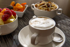 Cappuccino and nutritious oatmeal breakfast Stock Photo