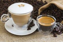 Cappuccino och ny espresso Fotografering för Bildbyråer