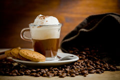 Cappuccino On Coffee Beans Stock Images