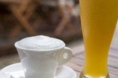 Cappuccino and orange juice Stock Photos