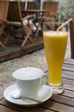 Cappuccino and orange juice Stock Photography