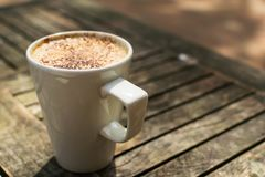 Cappuccino on an outside table royalty free stock photo
