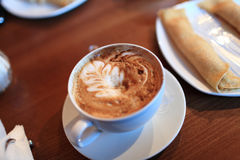 Cappuccino and pancake Stock Photography