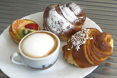 Cappuccino and pastry. Breakfast with cappuccino and pastry Royalty Free Stock Images