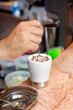 Cappuccino preparation. A barman is preparing a cappuccino Royalty Free Stock Photos