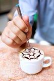 Cappuccino preparation. A barman is preparing a cappuccino Royalty Free Stock Photo