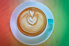 Cappuccino, red and green for background.  Stock Photo