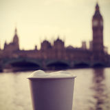 Cappuccino, River Thames and the Big Ben in London, UK, with a f Royalty Free Stock Photo