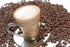 Cappuccino and roasted coffee beans Royalty Free Stock Photo