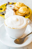 Cappuccino. With scone on the stone table Stock Image