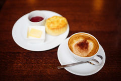 Cappuccino with Scottish Scone Stock Images