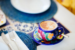 Cappuccino served in colorful cup Stock Images
