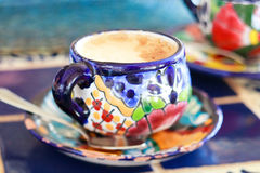 Cappuccino served in colorful cup Royalty Free Stock Photo