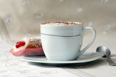 Cappuccino with small cake Stock Image