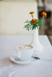 Cappuccino standing on the table Royalty Free Stock Photo