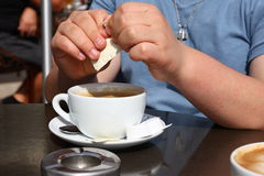 Cappuccino. With  sugar bags and foam Royalty Free Stock Photography