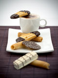 Cappuccino and sweets Stock Images