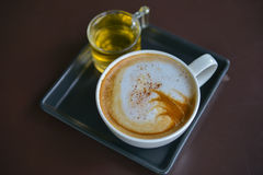 Cappuccino and tea Royalty Free Stock Photography