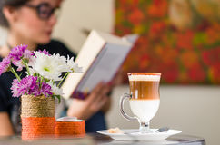 Cappuccino time. Girl about to drink coffee Royalty Free Stock Images