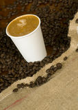 Cappuccino To Go on Counter Coffee Beans Stock Photography