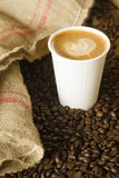 Cappuccino To Go Paper Cup Burlap Bag Roasted Coffee Beans Royalty Free Stock Photography
