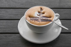 A cappuccino to relax by. A photo of a decorated cappuccino warm and ready to enjoy Stock Images