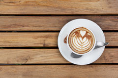Cappuccino top view on wood Royalty Free Stock Images