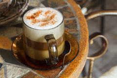Cappuccino. Transparent cup of cappuccino with cinnamon Stock Photo